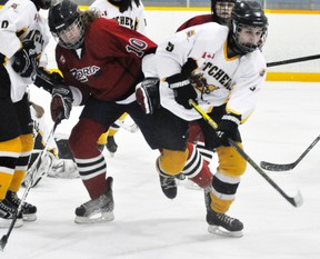 Brooklyn MacLean (right) of the Mitchell Midget girls hockey teams races for a loose puck against Zorra during WOGHL playoff action last Monday, Feb. 23. MacLean scored once in a 2-1 win. ANDY BADER/MITCHELL ADVOCATE