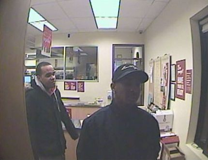 Norfolk County OPP have released a photo depicting two suspects involved in thefts at the LCBO on James Street in Delhi on Jan. 2, 2015. (Contributed Photo)