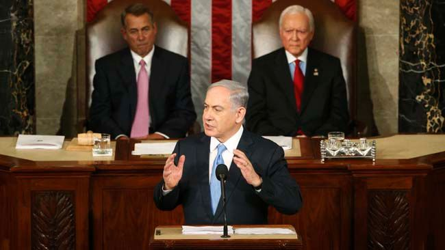 Israeli Prime Minister Benjamin Netanyahu (C) addresses a joint meeting of Congress in the House Chamber on Capitol Hill in Washington, March 3, 2015. U.S. Speaker of the House John Boehner (L) (R-OH) and President pro tempore of the U.S. Senate Orrin Hatch (R-UT) listen to Netanyahu. REUTERS/Jonathan Ernst