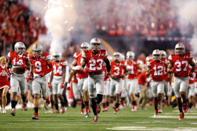 The Ohio State Buckeyes take the field prior to the College Football Playoff National Championship Game against the Oregon Ducks at AT&T Stadium on January 12, 2015 in Arlington, Tex. (Christian Petersen/Getty Images/AFP)