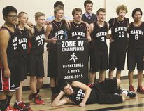 The Rosenort Redhawks pose with the Zone 4 banner after winning the 2014-15 title over the Westpark Royals during a hard fought championship final in Portage la Prairie. (Matt Hermiz/The Portage Daily Graphic)