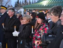 Mayerthorpe residents pay their respects during a candle lighting service a