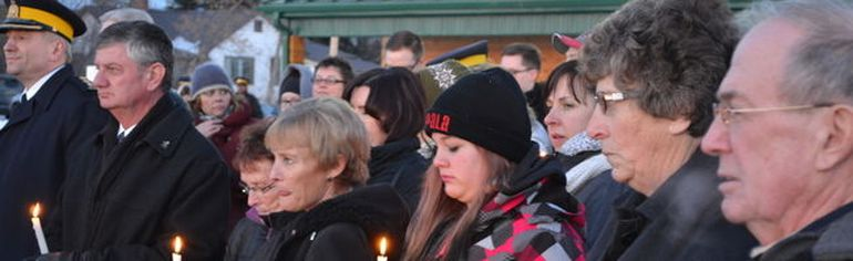 Mayerthorpe residents pay their respects during a candle lighting service at the Fallen Four memorial on Tuesday March 3, 10 years after four RCMP officers were gunned down north of Mayerthorpe.
