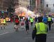 Runners continue to run towards the finish line of the Boston Marathon as an explosion erupts near the finish line of the race in this photo exclusively licensed to Reuters by photographer Dan Lampariello after he took the photo in Boston, Mass., in this April 15, 2013 file photo. (REUTERS/Dan Lampariello)
