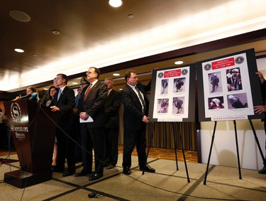 Boston FBI Special Agent in Charge Richard DesLauriers (L) speaks as photos of suspects in the Boston Marathon bombings are revealed during a news conference in Boston, Massachusetts April 18, 2013. REUTERS/Shannon Stapleton