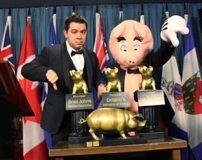 Canadian Taxpayers Federation's federal director Aaron Wudrick poses with the 17th Annual Teddy Government Waste awards in Ottawa on Wednesday, Mar. 4, 2015. (CTF/Handout/QMI Agency)