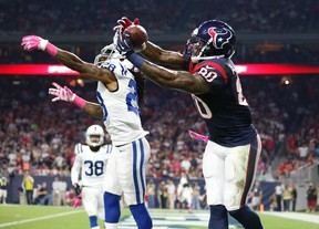 Houston Texans receiver Andre Johnson (80) catches a touchdown pass against Indianapolis Colts cornerback Greg Toler at NRG Stadium. (Matthew Emmons/USA TODAY Sports)