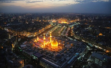 An aerial view shows the Shrines of Imam al-Abbas and Imam al-Hussein during the commemoration of Arbain in Kerbala, southwest of Baghdad December 13, 2014. Iraqi officials say millions of Shi'ite pilgrims from across Iraq and neighbouring countries were expected in Kerbala for the Arbain ritual, which marks the last of 40 days of mourning for the death of Imam Hussein that happened around 1,300 years ago. REUTERS/Abdul-Zahra