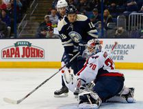 Washington Capitals goalie Braden Holtby (70) stops a tip from Columbus Blue Jackets winger David Clarkson during the second period Tuesday at Nationwide Arena.