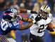 New Orleans Saints running back Pierre Thomas (right) tries to elude New York Giants defender Prince Amukamara during play in East Rutherford, N.J., December 9, 2012. (REUTERS/Mike Segar)