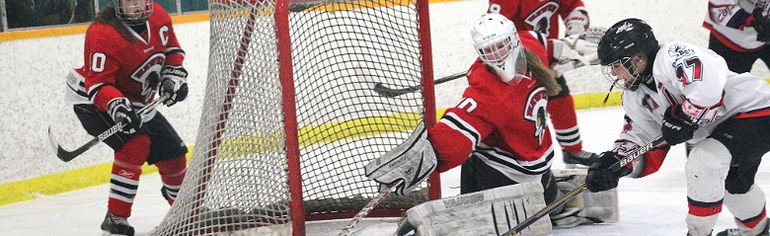 Sheridan Oswald scores a goal during the 2014-15 playoffs against the Pembina Valley Hawks. The Central Plains female midget Capitals opened their 2015-16 season with a win over PV, with Oswald notching the game-winner. (Matt Hermiz/TheGraphic/Postmedia Network)