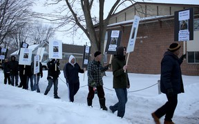 Floyd Porter, right, leads a peaceful protest against a convicted pedophile who neighbours say has moved to Chatham, Ont. from New Brunswick. He was joined by several residents of Taylor Avenue on Wednesday March 4, 2015, who carried placards and shouted slogans such as 'no peace, no rest,' to send a message that the man is not welcome in the community. (Ellwood Shreve, The Daily News)