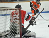 Prescott Flyers captain Ron Harrison takes a slap shot on Brockville Tikis goalie Chad Melbourne during Game 1 of the second round of the EOJHL playoffs on Wednesday at the Leo Boivin Community Centre. (JONATHON BRODIE/The Recorder and Times)
