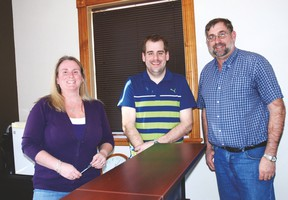 West Elgin Mutual Administrative Assistants, left, Laurie Sura and agents Paul McWilliam and John McWilliam moved into new offices at 195 Currie Rd. in downtown Dutton recently. The company hopes to announce plans soon for a new corporate office.