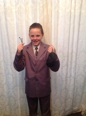 A U.K. boy was banned from participating in World Book Day at his school after he came to school dressed as Fifty Shades of Grey's Christian Grey. He carried zipties and a face mask. His mother defends her decision to send him to school in the costume. (QMI Agency/Twitter)