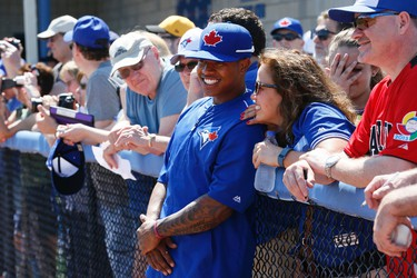 Marcus Stroman and his mother Adelin Auffanc on the sidelines as the Blue Jays Grapefruit League commences with a game against Pittsburgh in Dunedin, Florida,  on Tuesday, March 3, 2015. Stan Behal/Toronto Sun/QMI Agency