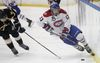 Kingston Voyageurs Brett Seney rides the boards to get the puck during Game 2 of the Ontario Junior Hockey League Eastern Conference finals. (Julia McKay/Kingston Whig-Standard/QMI Agency file photo)