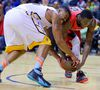 Marvin Phillips of the London Lightning and Richard Amardi of the Brampton A's fight for a loose ball. (Free Press file photo)