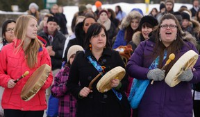 People demonstrate during a vigil honouring women from around the world to raise awareness about the Missing and Murdered Aboriginal Women movement and the Shine A Light campaign at Trent University in Peterborough, Ont., March 4, 2015. (CLIFFORD SKARSTEDT/QMI Agency)