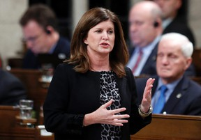 Health Minister Rona Ambrose speaks during Question Period in the House of Commons on Parliament Hill in Ottawa, Nov. 25, 2014. (CHRIS WATTIE/Reuters)