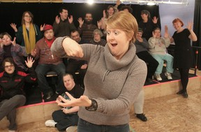 "As students from the H'art Centre give the American Sign Language sign for ""applause"" behind her, deaf actor Elizabeth Morris demonstrates the use of facial and body language. (Michael Lea/The Whig-Standard)"