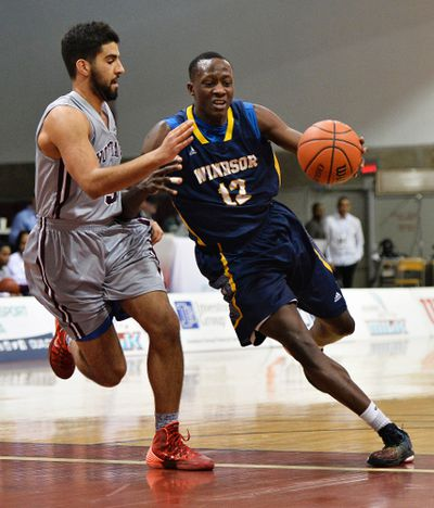Windsor Lancers� player #12 Rotimi Osuntola Jr. brings the ball up court while getting pressured by Ottawa Gee-Gees� #5 Mehdi Tihani during their OUA Wilson Cup Final Four Championship Semi-Final game at the University of Ottawa on Friday, March 6, 2015. Matthew Usherwood/Ottawa Sun