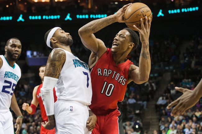 Raptors guard DeMar DeRozan (right) tries to shoot the ball around Hornets guard Mo Williams in Charlotte. (Jeremy Brevard-USA TODAY Sports)