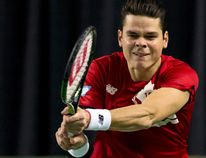 Canada's Milos Raonic hits a return to Japan's Tatsuma Ito during their Davis Cup match at the Doug Mitchell Thunderbird Sports Centre in Vancouver March 6, 2015. (REUTERS/Kevin Light)
