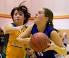 Ashley Cooper, of Glen Cairn, defends against Kristen Bisschop, of Northdale Central, during a girls game at the TVDSB elementary basketball championships, being held this weekend at several London high schools. (MIKE HENSEN, The London Free Press)