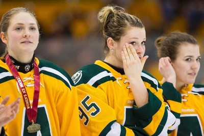 University of Alberta Pandas Jessica Kampjes (95) wipes away a celebratory tear during the medal ceremony for the Canada West Championships won versus the University of Manitoba Bisons in Game 2 at Clare Drake Arena at the University of Alberta in Edmonton, Alta., on Saturday, March 7, 2015. Ian Kucerak/Edmonton Sun/ QMI Agency