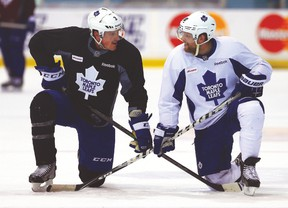 Leafs' Dion Phaneuf and Phil Kessel have a chat during practice. (DAVE ABEL/Toronto Sun)