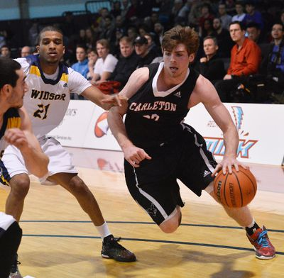 Carleton Ravens� #22 Mitchell Wood works his way by Windsor Lancers� #21 Khalid Abdel-Gabar during their OUA Wilson Cup Final Four Championship game at the University of Ottawa on Saturday, March 7, 2015. Matthew Usherwood/Ottawa Sun