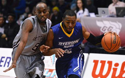 Ryerson Rams� #12 Best Aaron brings the ball up court while getting pressured by Ottawa Gee-Gees� #8 Johnny Beranemeskel during their OUA Wilson Cup Final Four Championship Bronze Medal game at the University of Ottawa on Saturday, March 7, 2015. Matthew Usherwood/Ottawa Sun