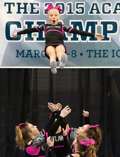 Members of the Outlaws Mustangs cheer team take part in the 2015 ACA Cheerleading Championships at West Edmonton Mall, in Edmonton Alta., on Sunday March 8, 2015. Over 2,800 cheerleaders from across Canada will be taking part in the event. David Bloom/Edmonton Sun/QMI Agency