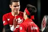 Canada's Milos Raonic congratulates Japan's Kei Nishikori following their Davis Cup match at the Doug Mitchell Thunderbird Sports Centre in Vancouver March 8, 2015. (REUTERS/Kevin Light)