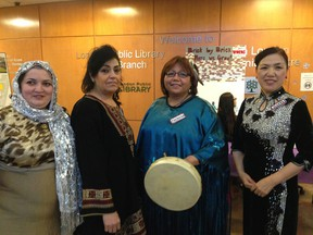 Kamala Hasanova, Fawzie Hamze, Theresa Kwissiwa and Zhujuan Qiu wear traditonal clothing from Azerbaijan, Palestine, First Nations and China at the International Women's Day celebration in London. (JONATHAN SHER, The London Free Press)