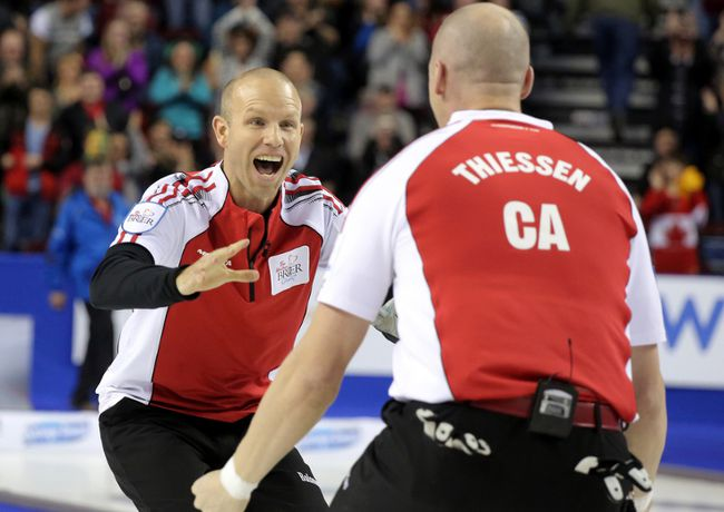 Team Canada skip Pat Simmons rushes toward lead Nolan Thiessen after defeating Team Northern Ontario in the gold medal game at the Tim Horton's Brier 2015 at the Scotiabank Saddledome in Calgary, Alberta, on  Sunday, March 8, 2015. Mike Drew/Calgary Sun/QMI AGENCY