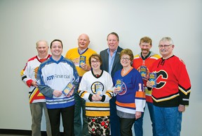 During the committee of the whole meeting on Wednesday, Mar. 4 town councillors, sporting their hockey jerseys, got MLA Pat Stier to pose for a photo supporting Pincher Creek's bid in Kraft Hockeyville. John Stoesser photo/Pincher Creek Echo.