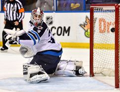 Jets goalie Michael Hutchinson gives up one of his four goals on just seven shots.