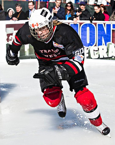 Nathan Oostenbrink skates around a corner during the National Shootout event featuring Canadian skaters at Red Bull Crashed Ice in Edmonton, Alta., on Thursday, March 12, 2015. Codie McLachlan/Edmonton Sun/QMI Agency