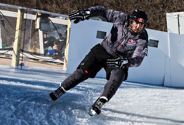 Roman Bertolutti skates around the final corner during the National Shootout event featuring Canadian skaters at Red Bull Crashed Ice in Edmonton, Alta., on Thursday, March 12, 2015. Codie McLachlan/Edmonton Sun/QMI Agency