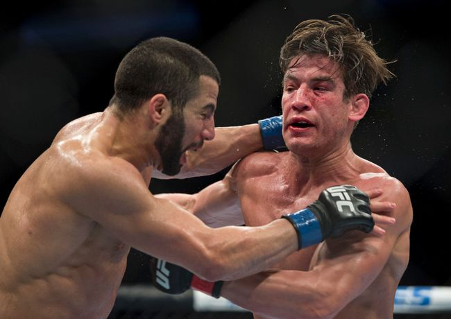 Sam Stout (red gloves) fights John Makdessi during UFC 154 at the Bell Center on November 17, 2012. (JOEL LEMAY/QMI AGENCY)