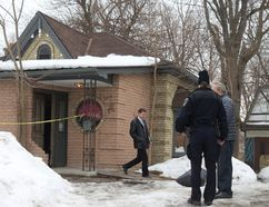 Police speak to a man who lives at the rear of 504 English St., where a 36-year-old man was shot dead about 10:30 p.m. Monday. CRAIG GLOVER/The London Free Press/QMI Agency