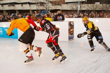 Skaters Max Dunne (left) Marcel Beauchesne (centre) and Miika Miettinen race in the elimination rounds during the Red Bull Crashed Ice Ice Cross Downhill World Championship in Edmonton, Alta., on Friday,  March 13, 2015. Ian Kucerak/Edmonton Sun/ QMI Agency