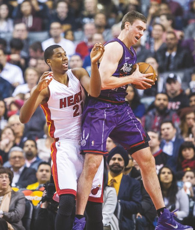 Tyler Hansbrough grabs a rebound in front of the Miami Heat's Hassan Whiteside on Friday night. (ERNEST DOROSZUK/Toronto Sun)