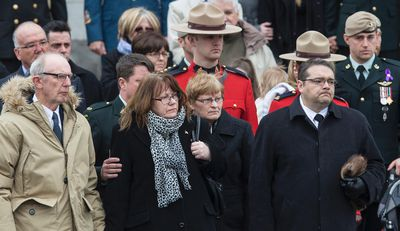 Mourners watch as the remains of Sergeant Andrew Doiron are carried to a hearse following his funeral at the Notre-Dame Cathedral Basilica in Ottawa on Saturday March 14, 2015. Errol McGihon/Ottawa Sun/QMI Agency