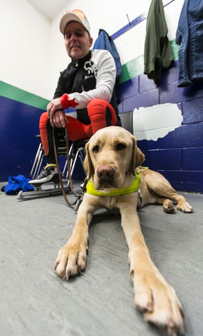 Blind and deaf speed skater Kevin Frost of Ottawa with his dog Lewis before heading to the ice surface to train at the Bob McQuarrie Recreation Complex in Orleans.March 13, 2015. Errol McGihon/Ottawa Sun/QMI Agency