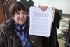 TCH resident Bonnie Booth who holds correspondence -- including legal threats -- she has had with social housing officials. (CRAIG ROBERTSON, Toronto Sun)