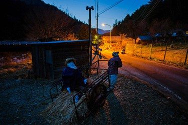 Scarecrows are seen at sunset in Nagoro on Shikoku Island in southern Japan on Feb. 23, 2015. (REUTERS/Thomas Peter)