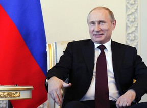 Russian President Vladimir Putin smiles as he meets with his Kyrgyz counterpart Almazbek Atambayev (not pictured) at the Constantine (Konstantinovsky) Palace in St. Petersburg on March 16, 2015. (REUTERS/Anatoly Maltsev/Pool)